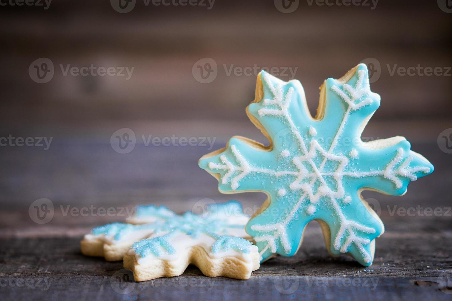 Snowflake cookies on wooden background photo