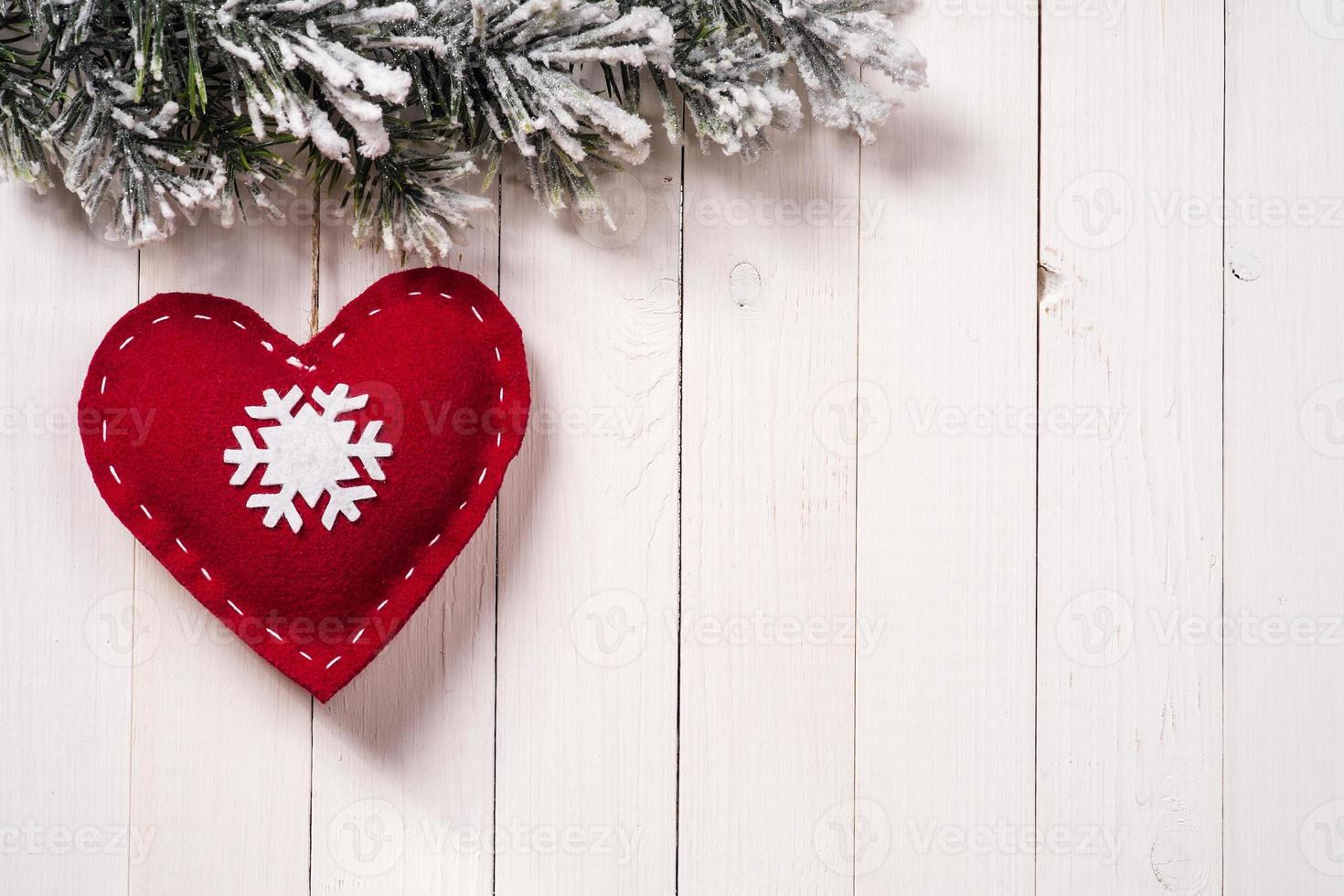 Christmas decoration in the form of heart with fir branches photo