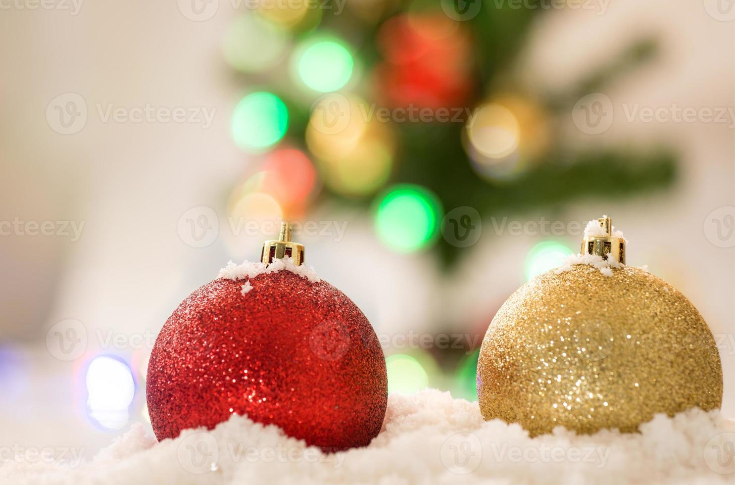 red and gold chrismas ball on snow with chrismas photo