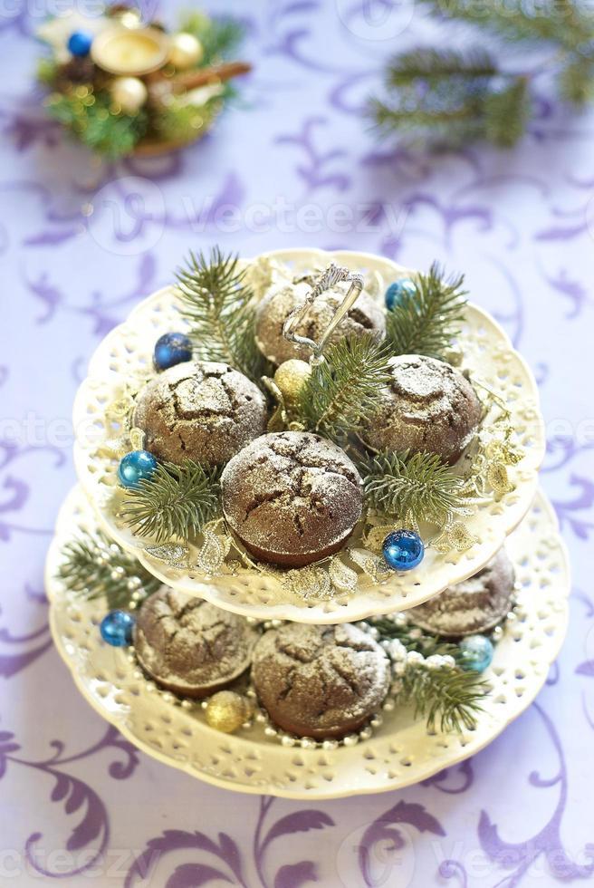 Christmas chocolate cakes with powdered sugar photo