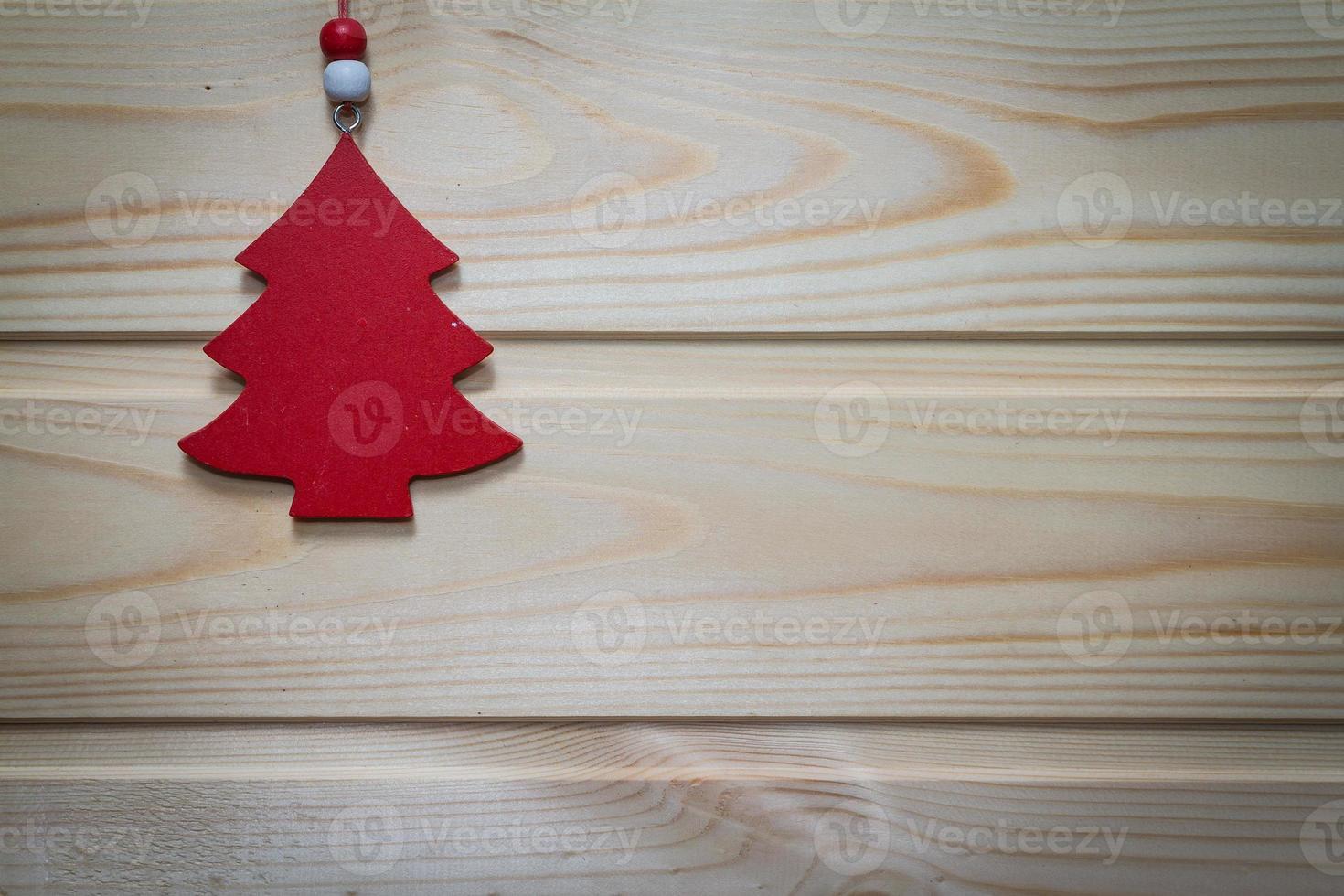 Fondo de madera de navidad decorado con un juguete. foto
