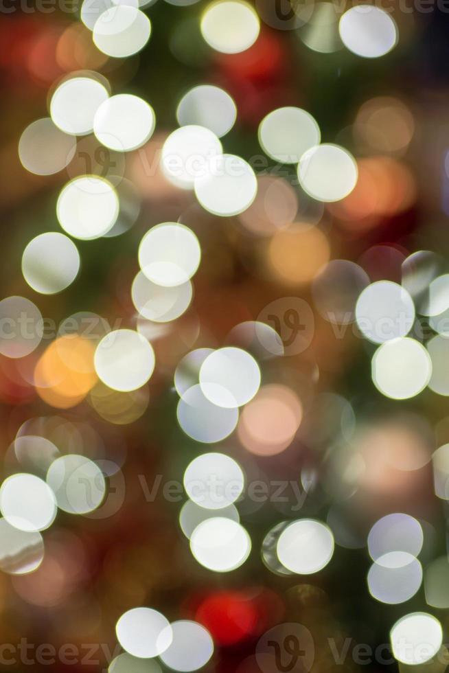 Abstract Christmas background with bokeh light photo