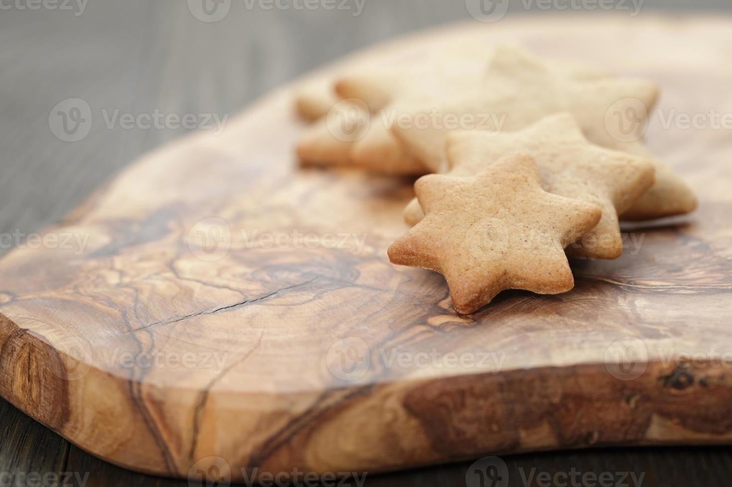 homemade star shape ginger cookies on olive board photo