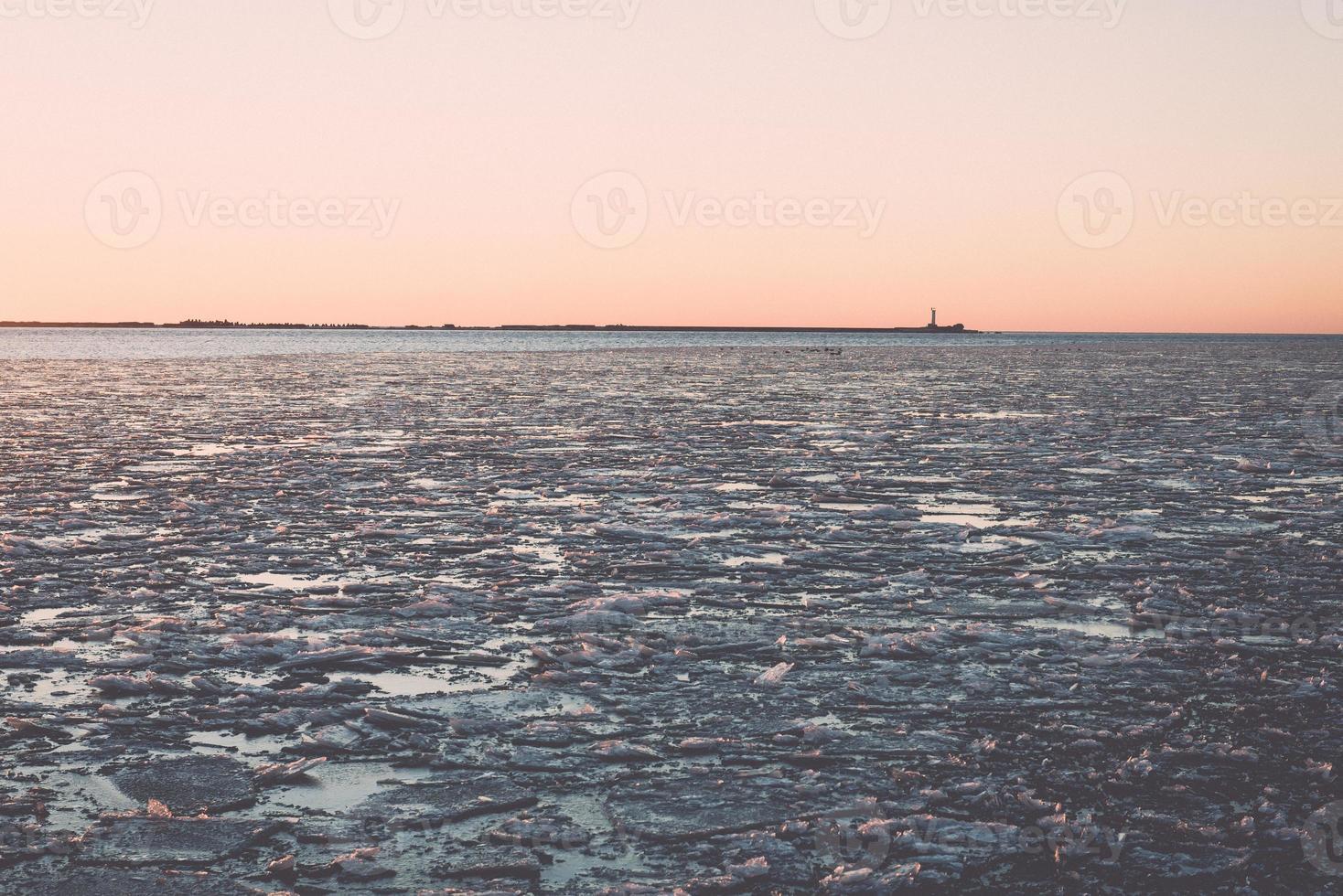sunset over frozen sea - vintage retro effect photo