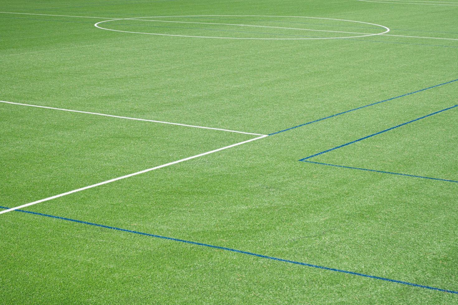 Fondo de campo de fútbol con césped artificial. foto