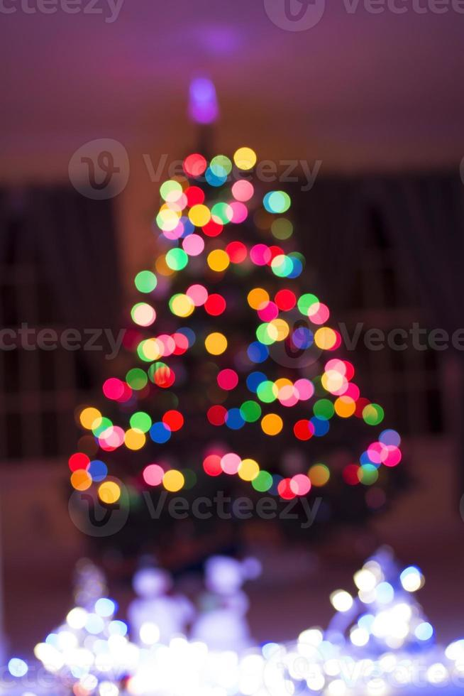Christmas tree light bokeh on for background photo