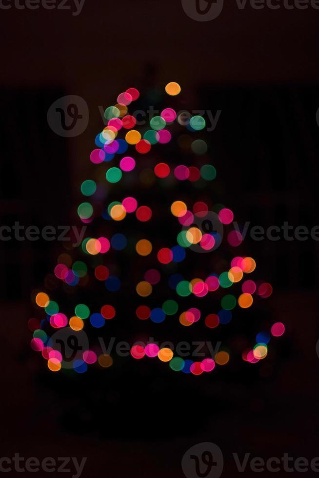 Christmas light bokeh on black background photo