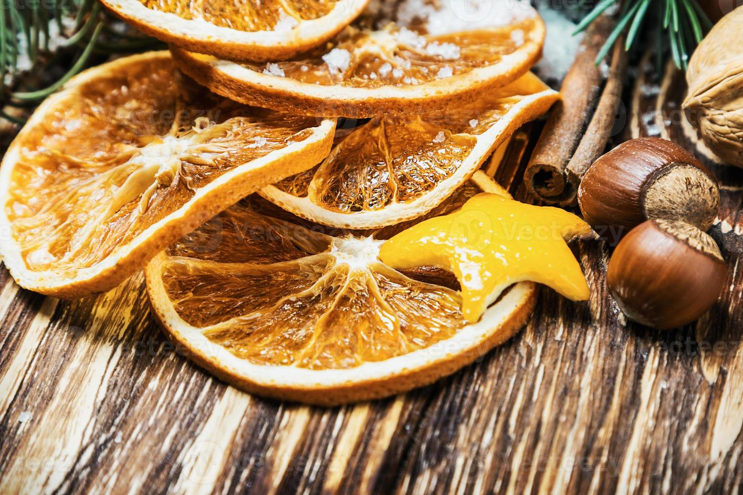 dried oranges with nuts for the Christmas holiday photo
