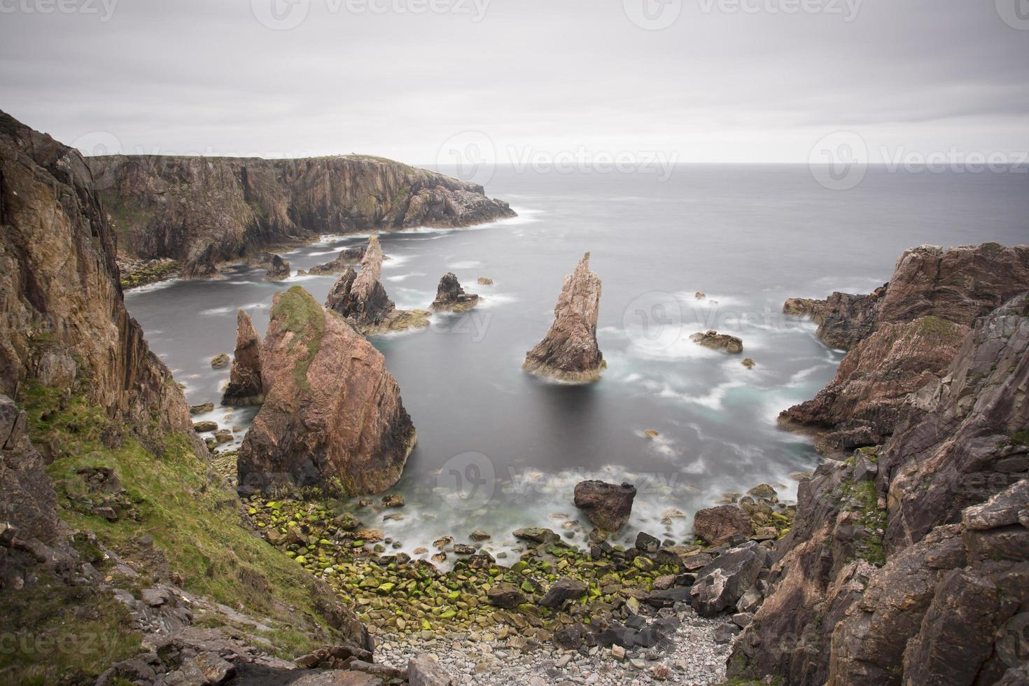 bay with sea stacks in rural scotland photo