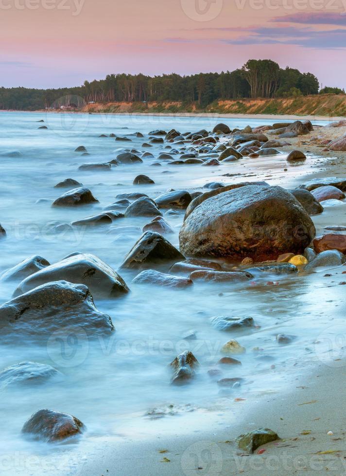 Rocky coast of the Baltic Sea at sunset photo