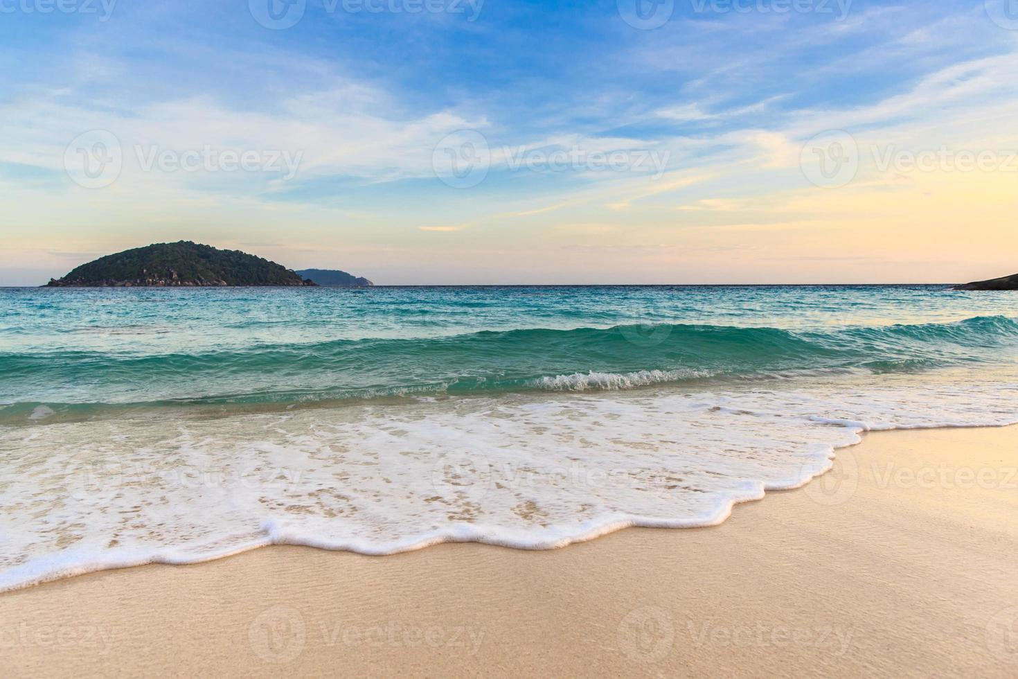 Beautiful beach and crystal clear sea at tropical island, photo