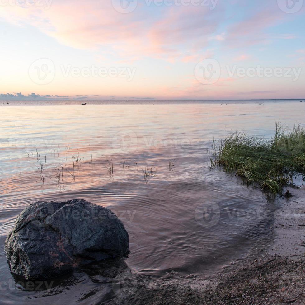 beautiful sunrise in the sea at the wild beach photo