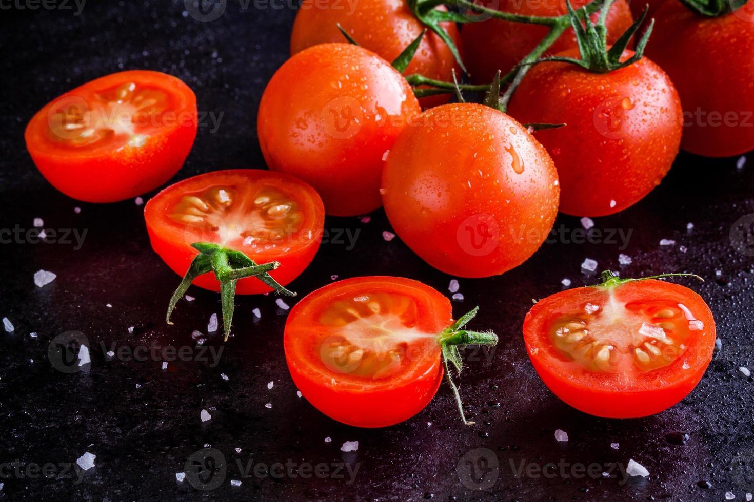 fresh organic cherry tomatoes with drops and sea salt photo