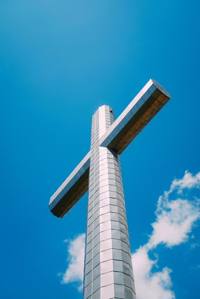 Steel cross on a mountain top photo