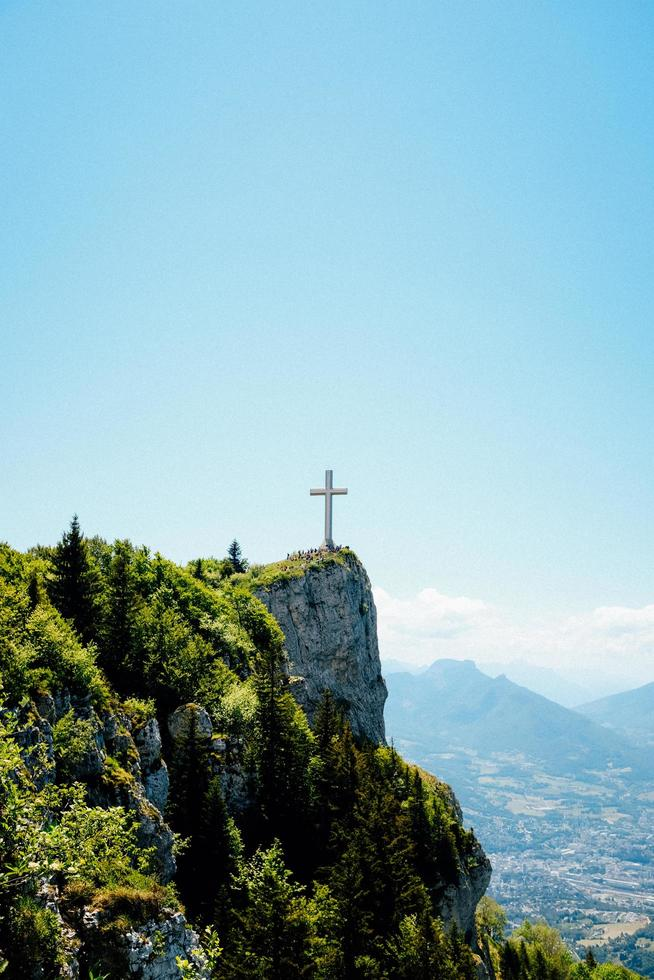 Cross on top of a mountain photo