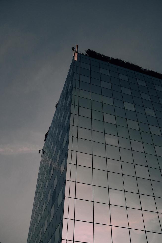 Concrete building under gray sky photo