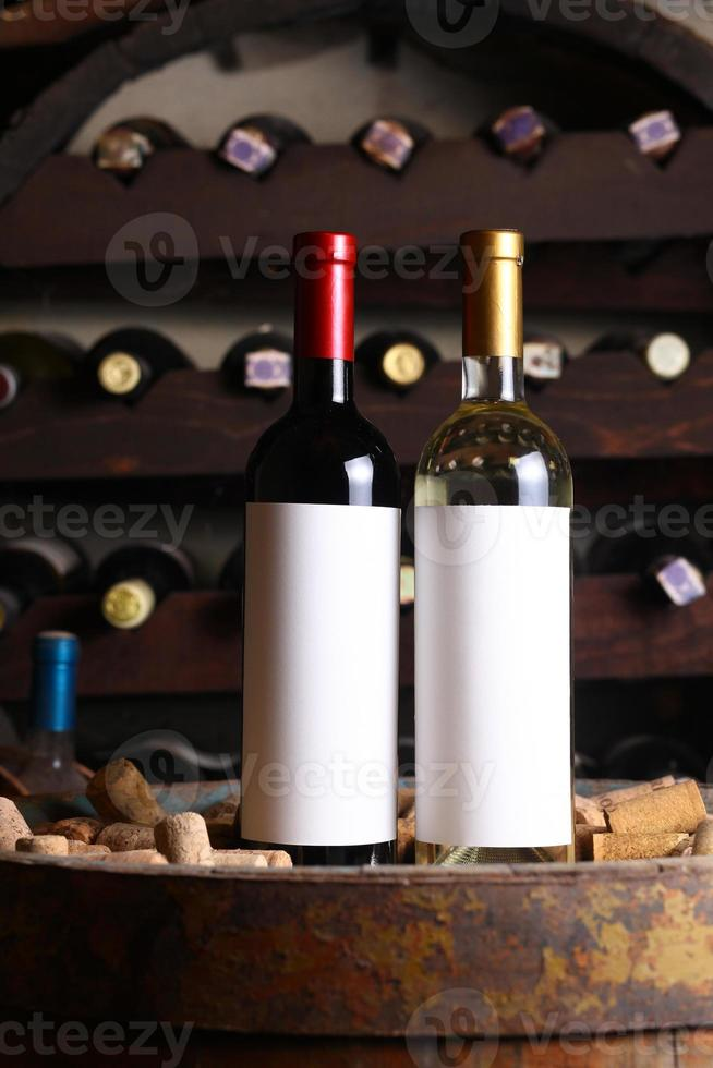 Red and white wine in cellar photo