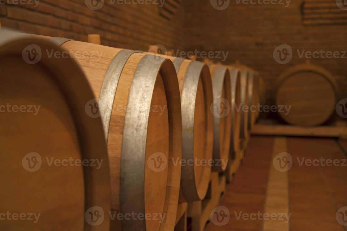 Wooden barrels in wine cellar. photo