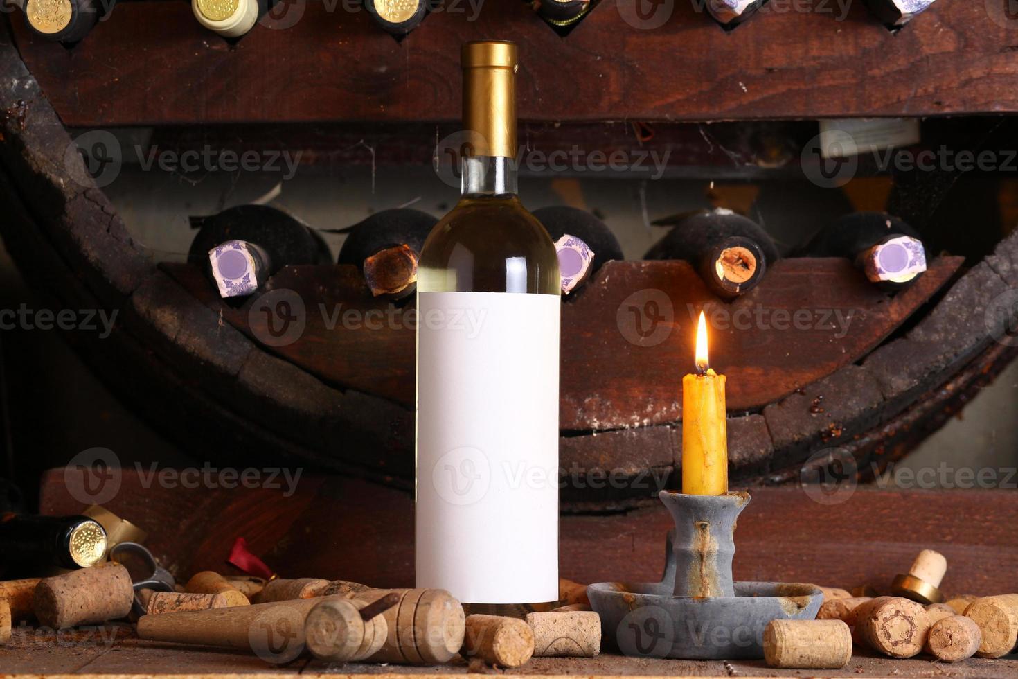 Vintage white wine in cellar photo