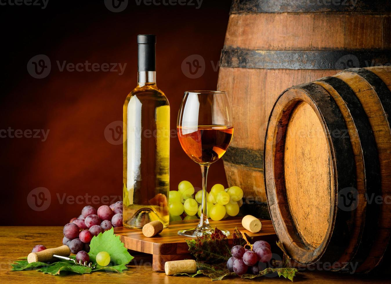 white wine and grapes with barrel photo