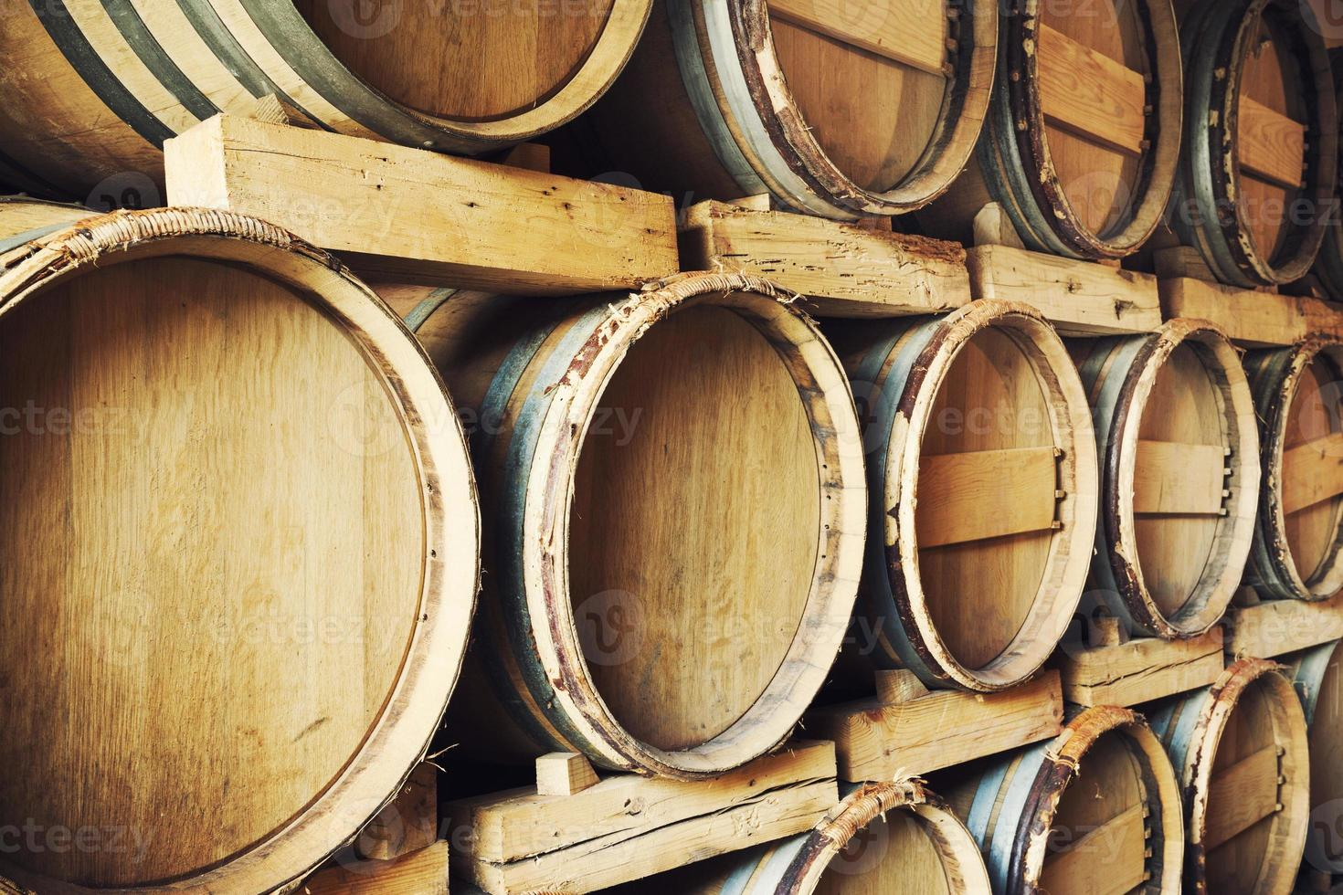 Barrels stacked in a wine cellar photo