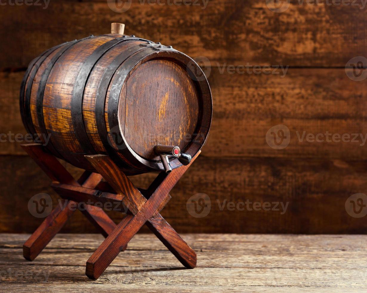 wooden barrel on rustic wooden background photo