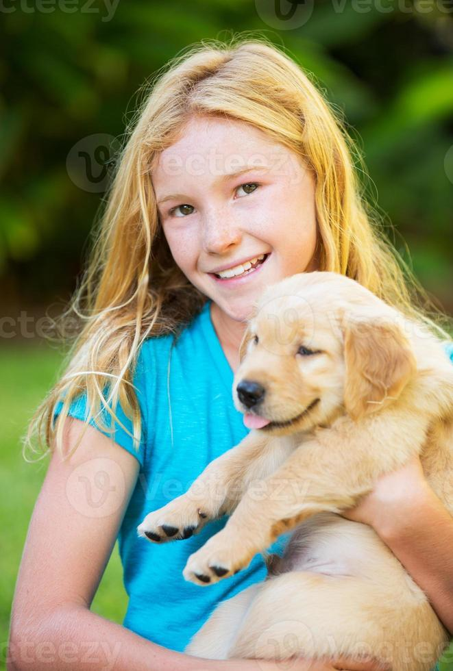 Cute Young Girl with Puppies photo