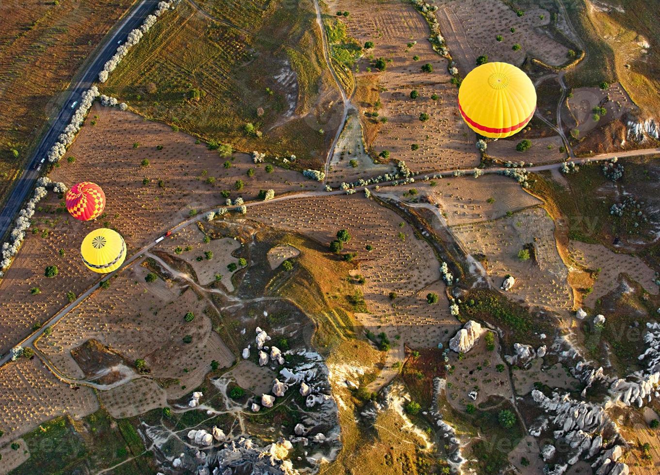 Balloon flight over ancient rocks, Cappadocia, Turkey. photo