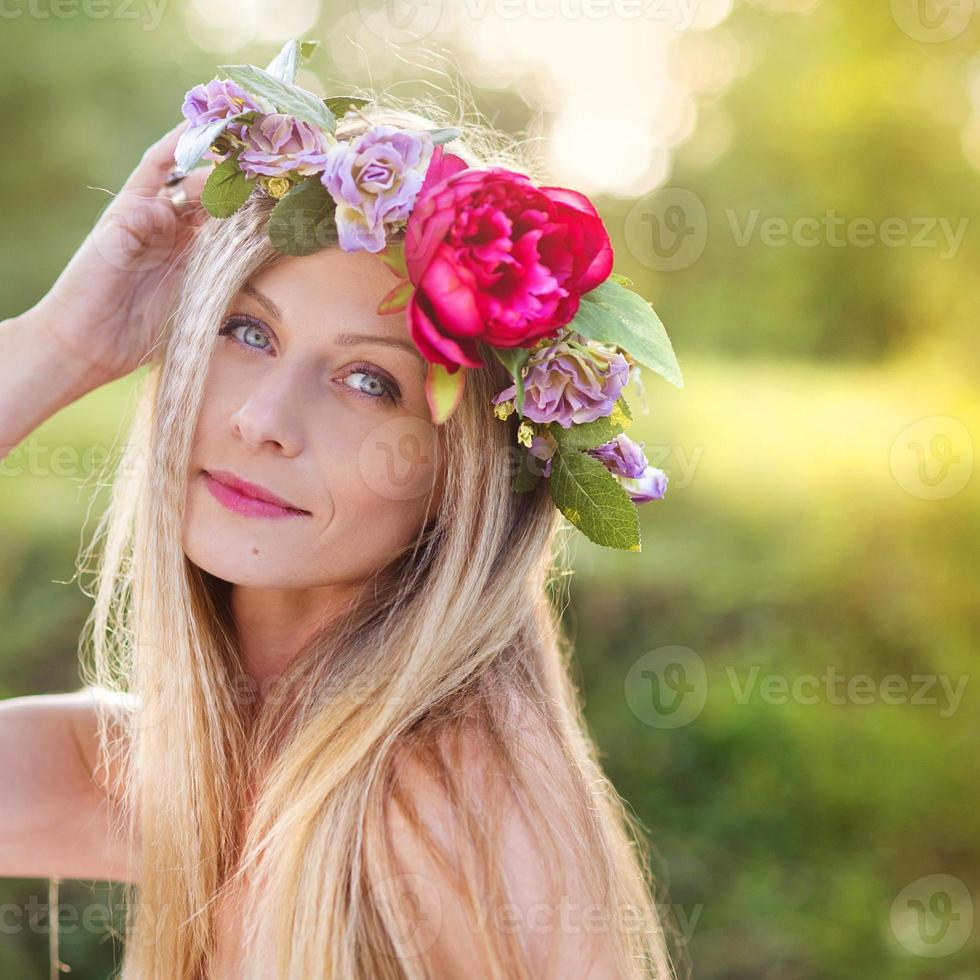 Beautiful woman with flower wreath. photo