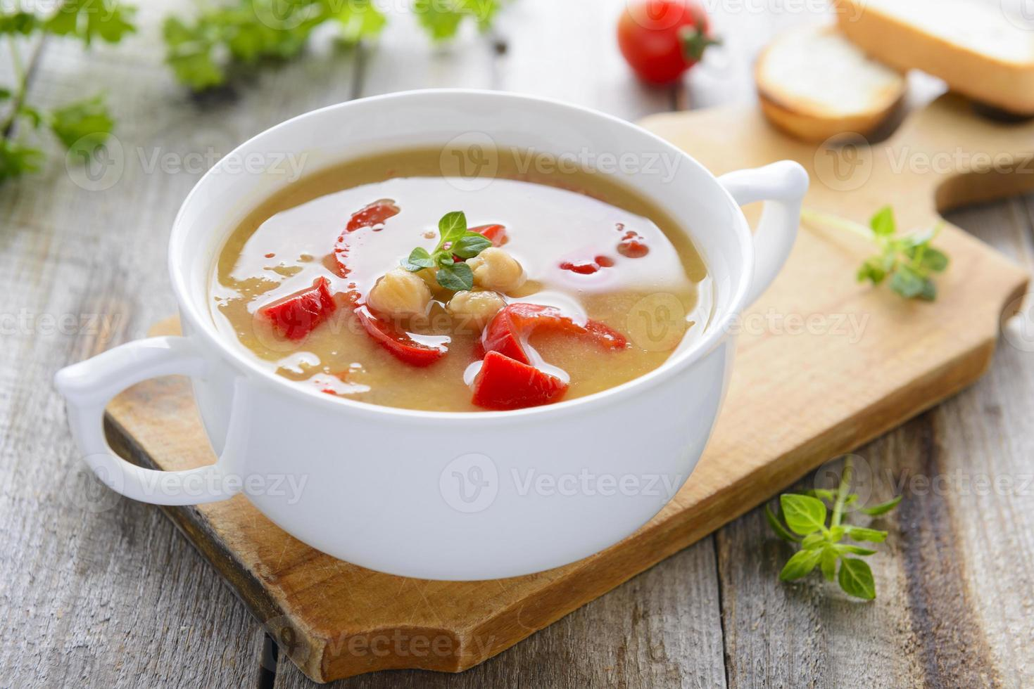 Hot vegetarian soup from chickpeas and lentil photo