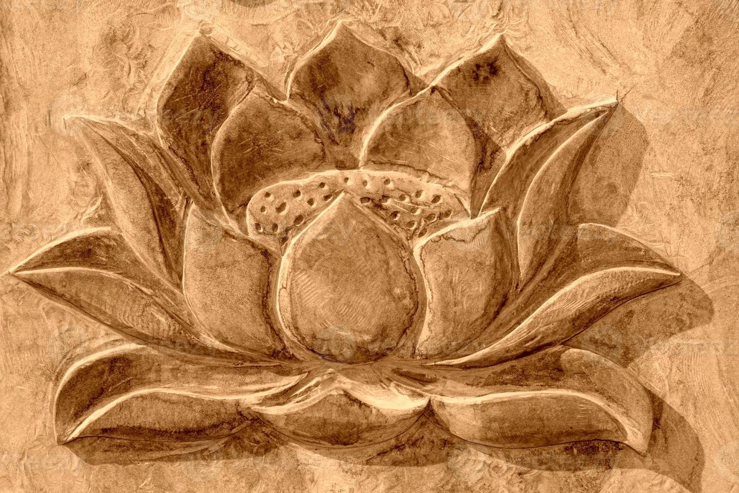 lótus esculpido na rocha cinza foto