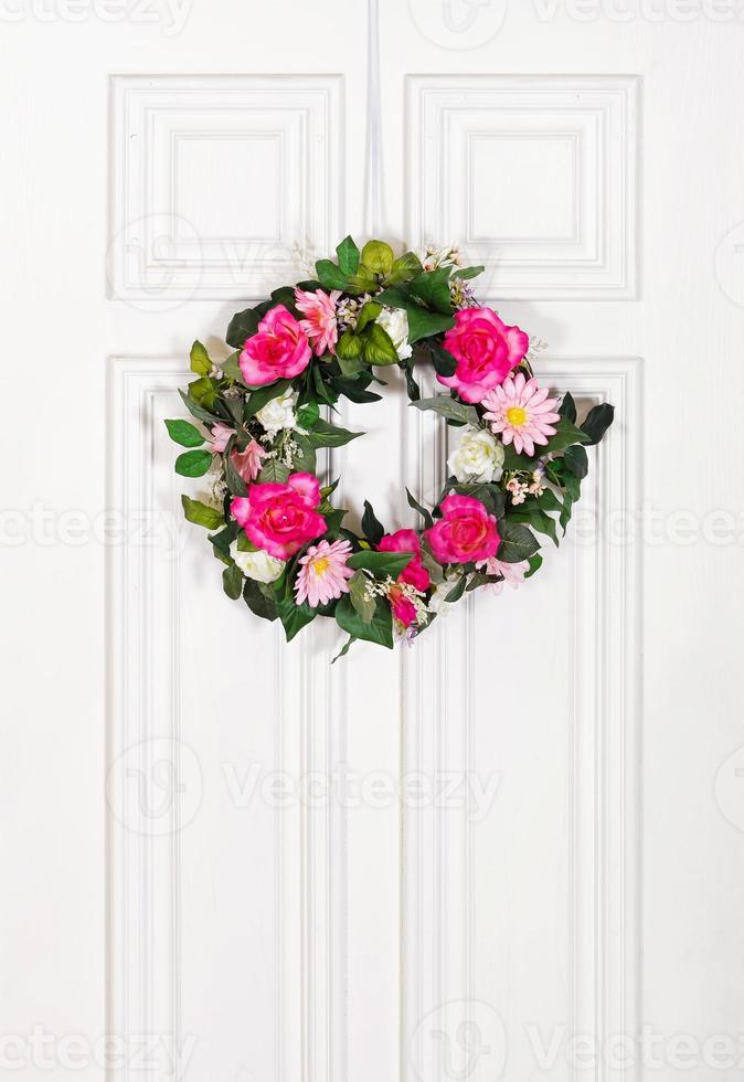 Floral wreath on white door photo