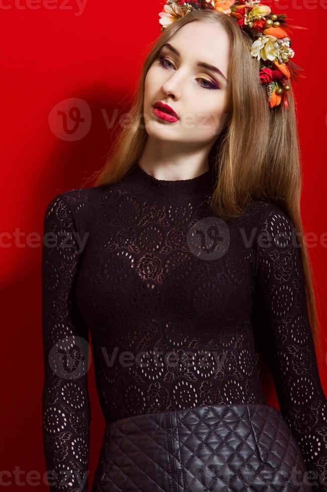 Beautiful girl with long hair wearing a wreath photo