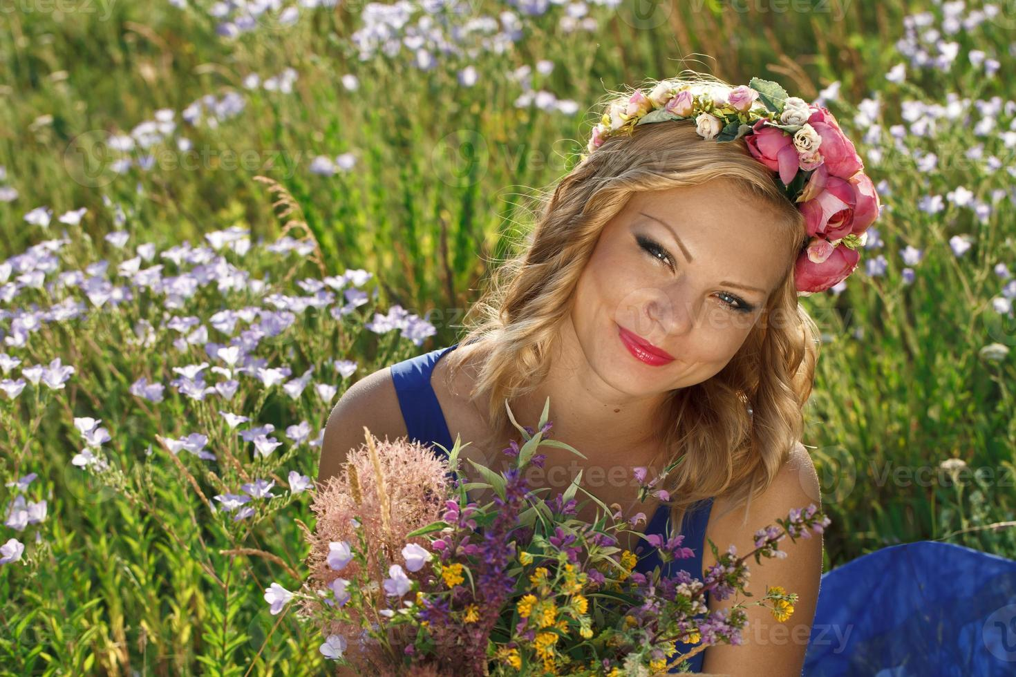 beautiful young girl with flowers photo