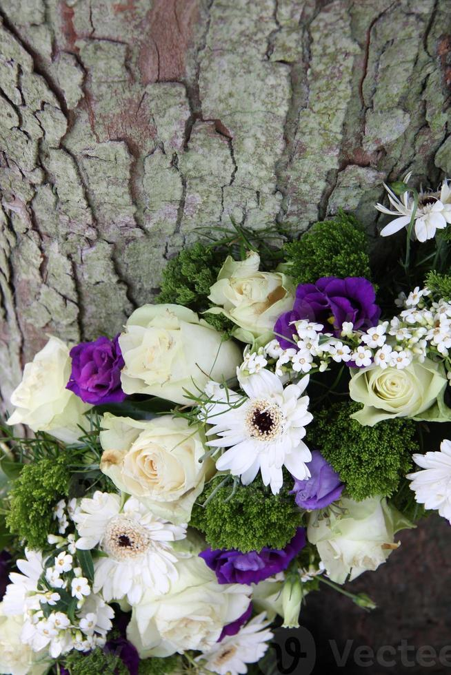 detail of a Sympathy wreath in white and purple photo