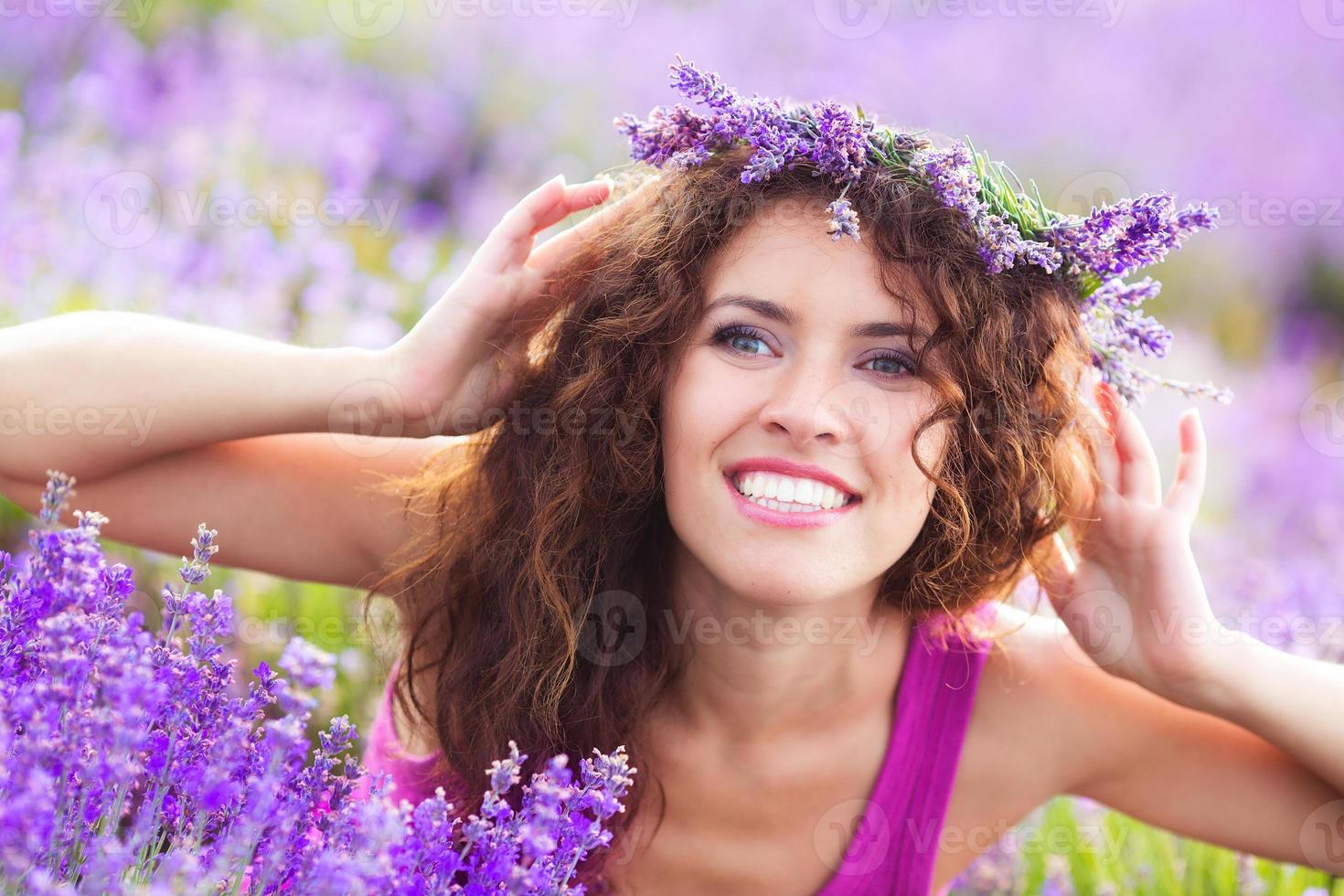 Girl on lavender field photo