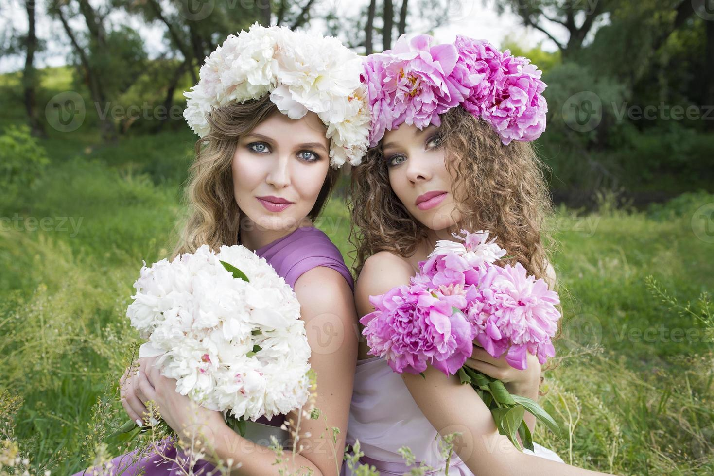 Two girls with rose peony wreath photo