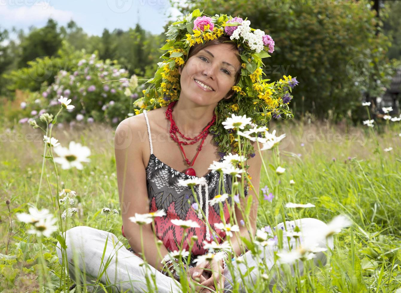 Portrait of hippie girl in a wreath photo
