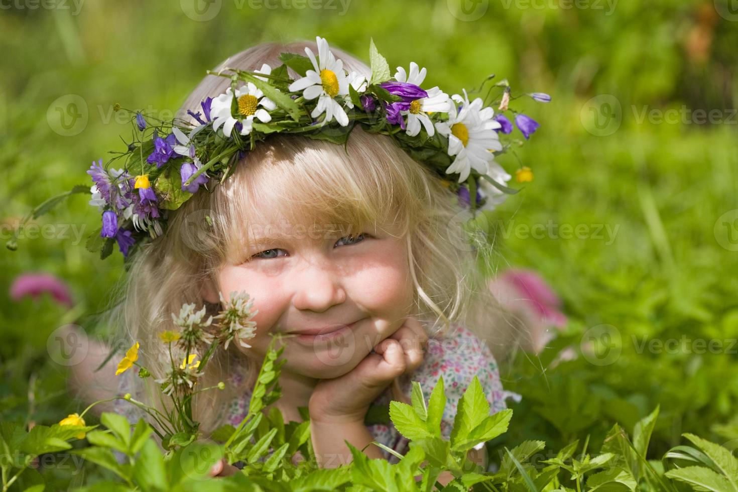 happy little girl on green meadow photo