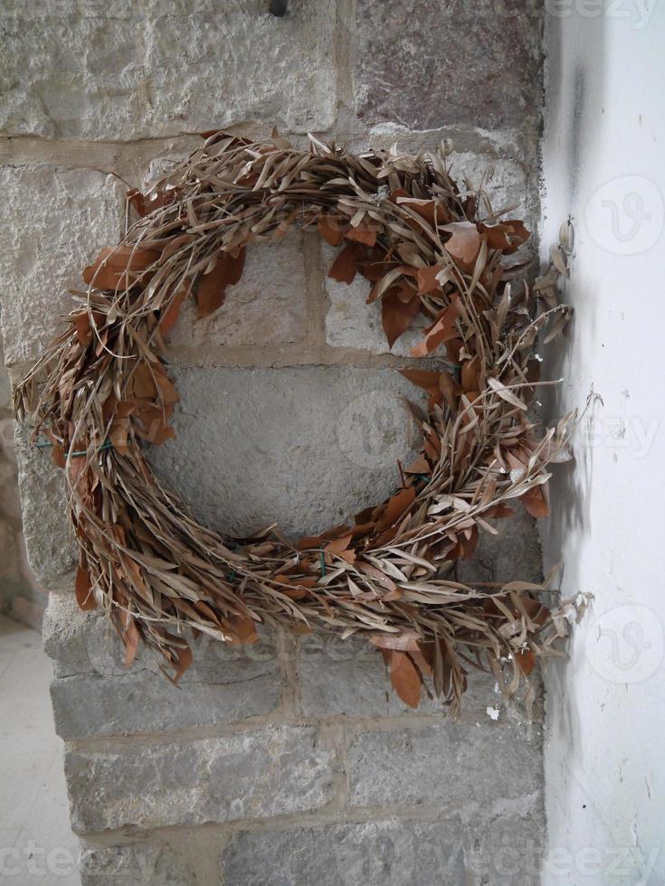 Wheat Wreath Hanging on a wall, Montenegro. Old Bar photo