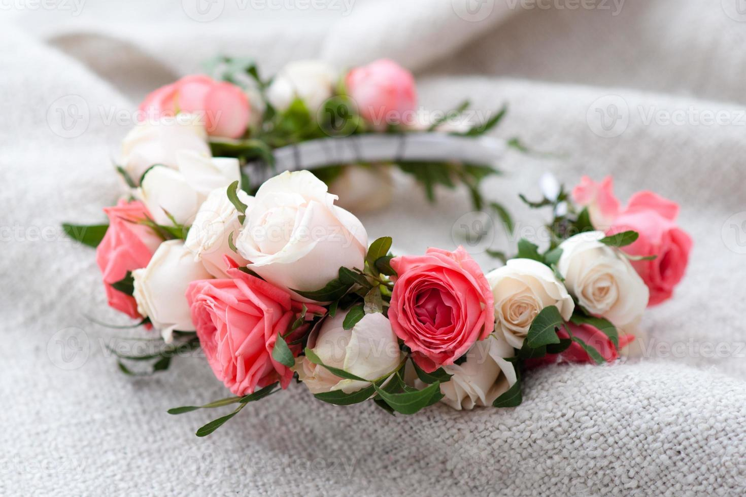 tiara of artificial roses on wooden background. photo