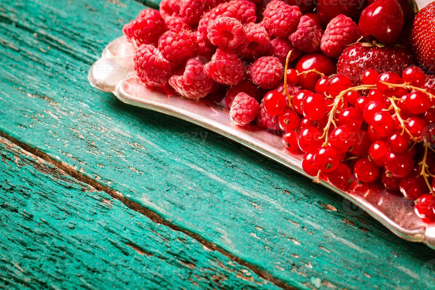 Fresh summer berries,wooden background,healthy food. photo