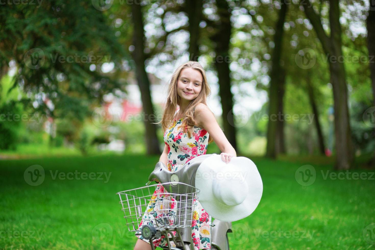 Young girl spending her time in the countryside photo