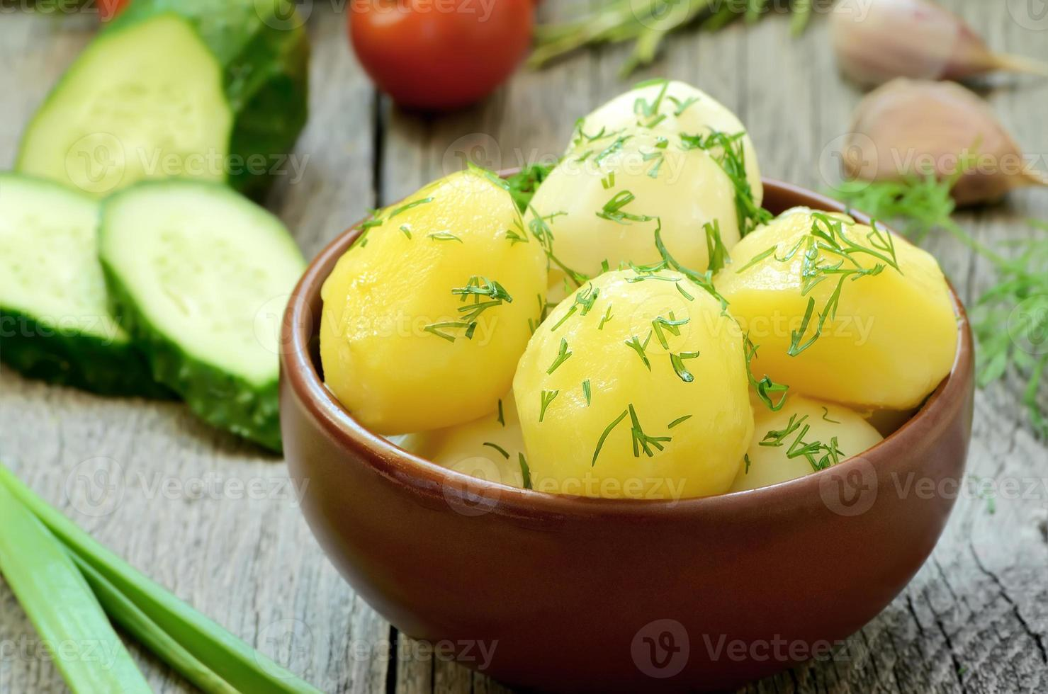 Boiled potatoes with dill photo