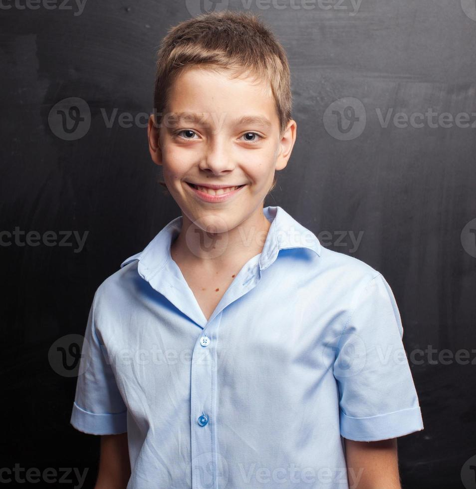 Boy near blackboard photo