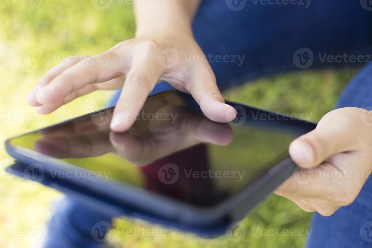 Woman Use Tablet at Park photo