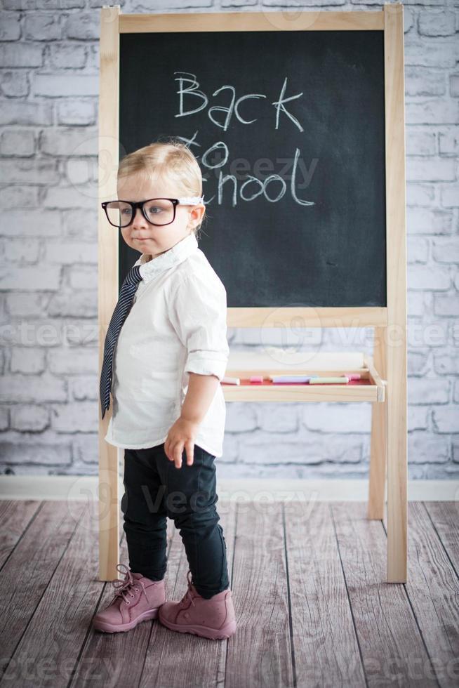 Little baby girl with blackboard photo