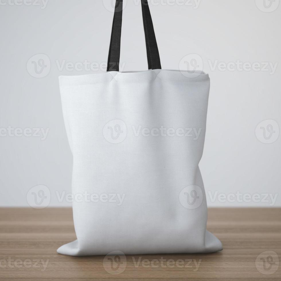 bolsa de algodón blanco sobre la mesa foto