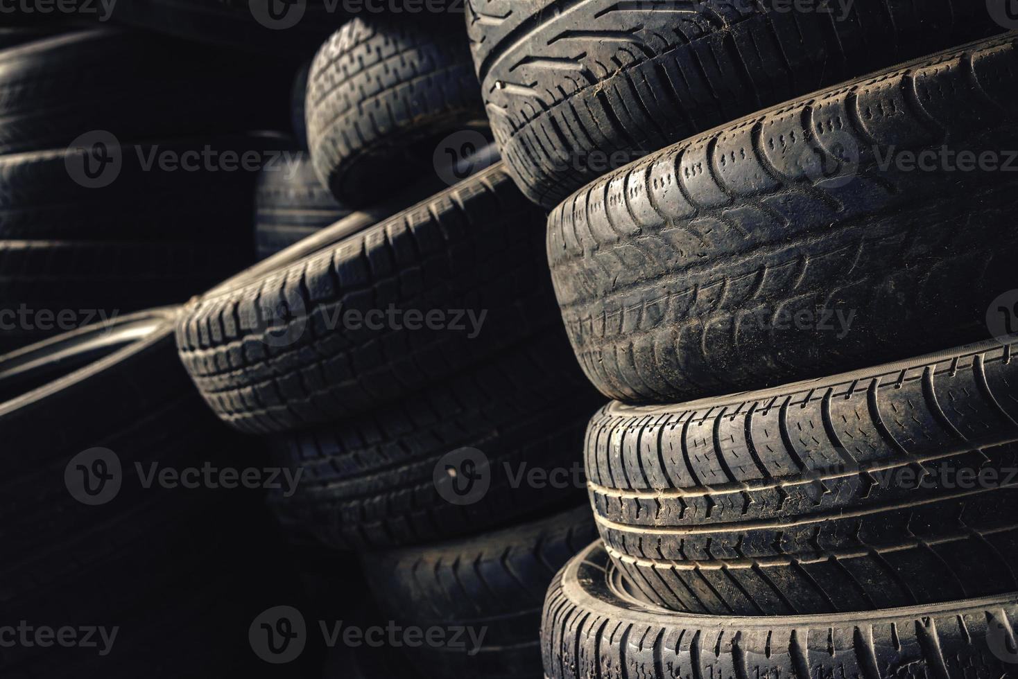 Column stack of old used car tires photo
