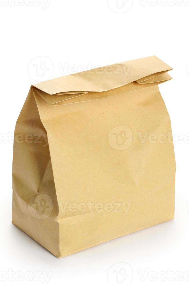 Closed brown paper bag isolated on a white background photo